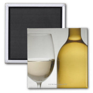 Close up of glass of white wine and wine bottle refrigerator magnets