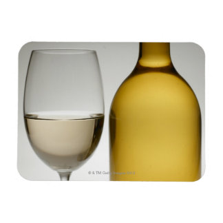 Close up of glass of white wine and wine bottle magnet