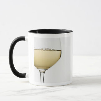 Close up of glass of white wine on white mug