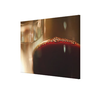 Close-up of glass with red wine canvas print