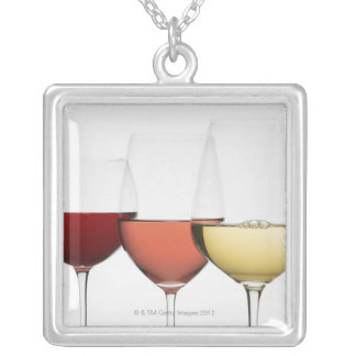 Close up of glasses of different wines silver plated necklace