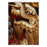 Close up of gold dragon on temple pillar greeting card