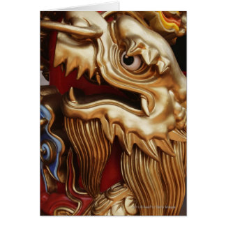 Close up of gold dragon on temple pillar card
