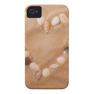 Close up of heart shape made of shells on sand iPhone 4 covers