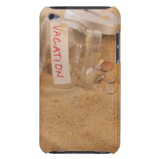 Close up of jar with coins spilled on sand barely there iPod case
