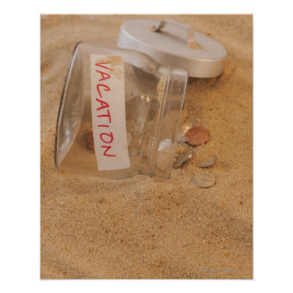 Close up of jar with coins spilled on sand poster