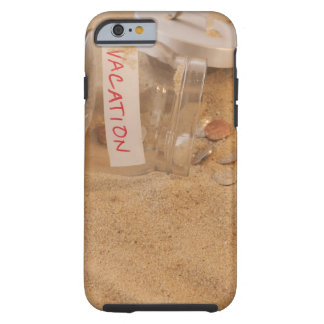 Close up of jar with coins spilled on sand tough iPhone 6 case