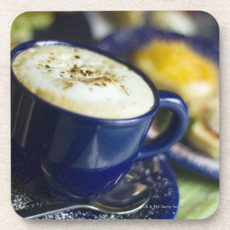 Close-up of latte on table coaster