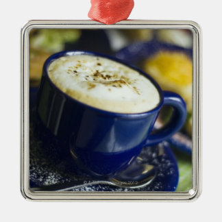 Close-up of latte on table Silver-Colored square decoration