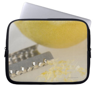 Close-up of lemon and grater laptop sleeve