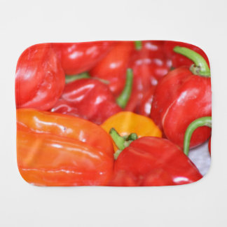 Close up of mainly red hot peppers burp cloth