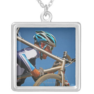 Close up of man cyclocross racing silver plated necklace