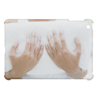 Close up of man holding towels cover for the iPad mini