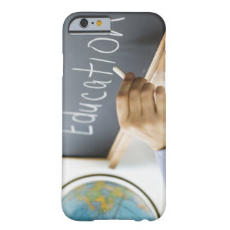Close-up of man's hand writing ''education'' on barely there iPhone 6 case
