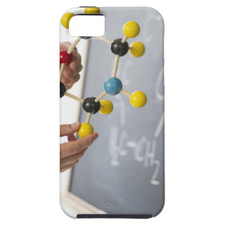 Close-up of man's hands holding molecule model, case for the iPhone 5