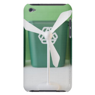 Close up of model of wind turbine and garbage barely there iPod cases