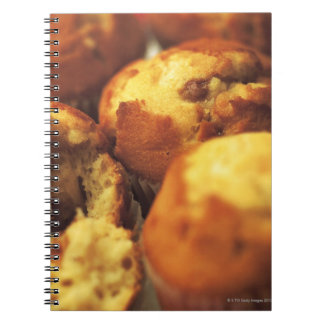 close-up of muffins (blurred) spiral notebook