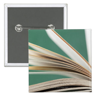 Close-up of open book, studio shot pinback button