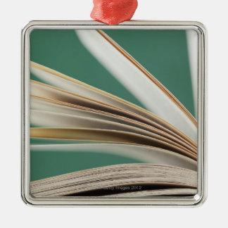 Close-up of open book, studio shot Silver-Colored square decoration