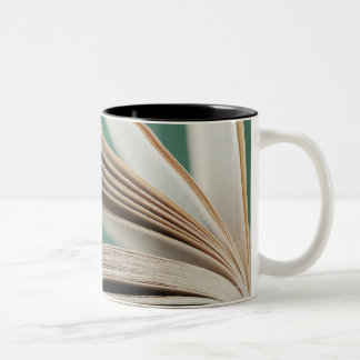 Close-up of open book, studio shot Two-Tone coffee mug