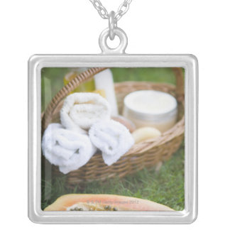 Close-up of papaya massage therapy treatment silver plated necklace