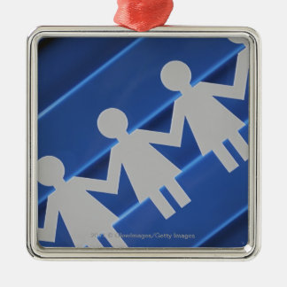 Close-up of paper chain dolls christmas ornament