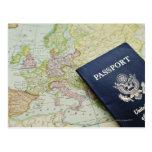 Close-up of passport lying on European map