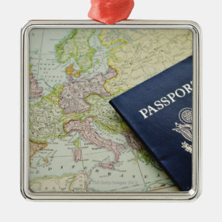 Close-up of passport lying on European map Christmas Ornament