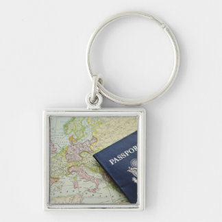 Close-up of passport lying on European map Key Ring