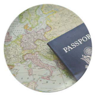 Close-up of passport lying on European map Plate