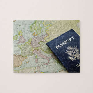Close-up of passport lying on European map Puzzle