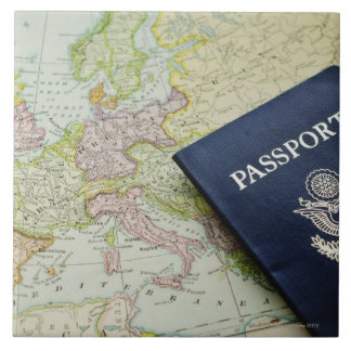 Close-up of passport lying on European map Tile