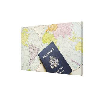 Close-up of passport lying on map canvas print