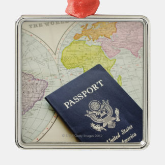 Close-up of passport lying on map christmas ornament