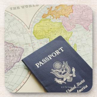 Close-up of passport lying on map coaster