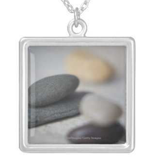 Close-up of pebbles silver plated necklace
