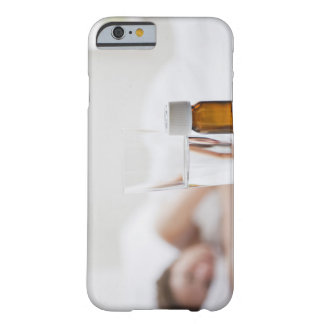 Close up of pill bottle with sick woman in barely there iPhone 6 case