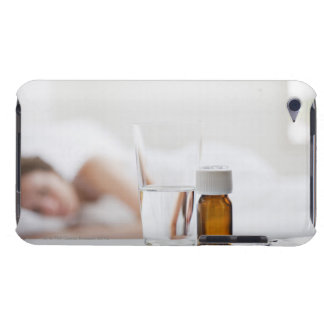 Close up of pill bottle with sick woman in barely there iPod case