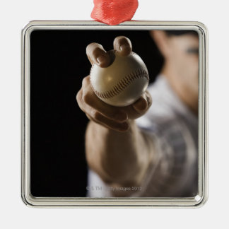 Close up of pitcher holding baseball christmas ornament