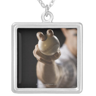 Close up of pitcher holding baseball silver plated necklace
