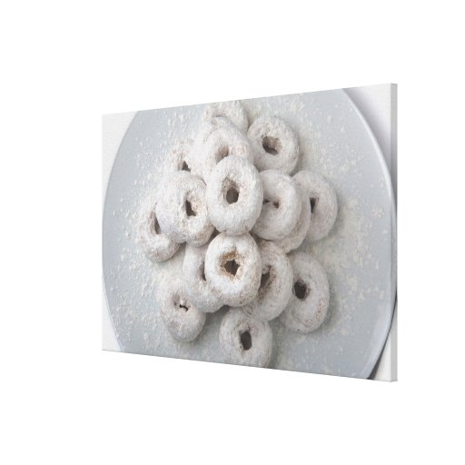 Close-up of powdered doughnuts in a plate stretched canvas print