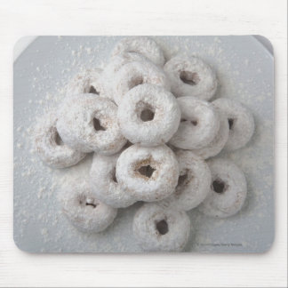 Close-up of powdered doughnuts in a plate mouse mat