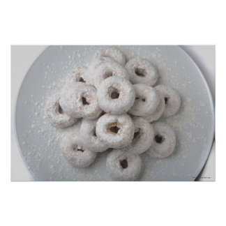 Close-up of powdered doughnuts in a plate poster