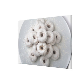 Close-up of powdered doughnuts in a plate stretched canvas prints