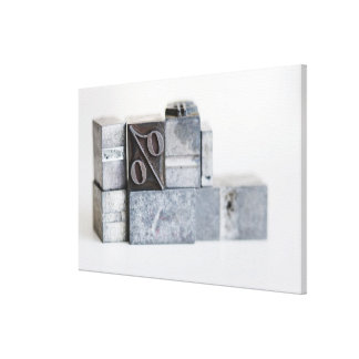 Close up of printing blocks with percentage sign stretched canvas print