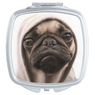Close up of pug wearing hoodie. compact mirrors