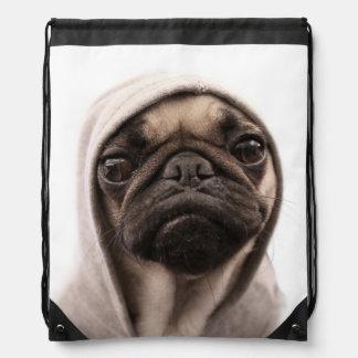Close up of pug wearing hoodie. drawstring bag
