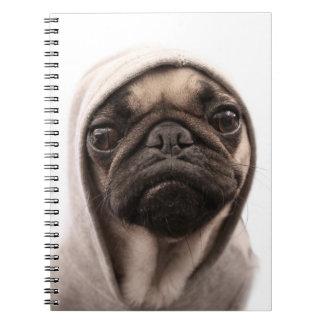 Close up of pug wearing hoodie. notebook
