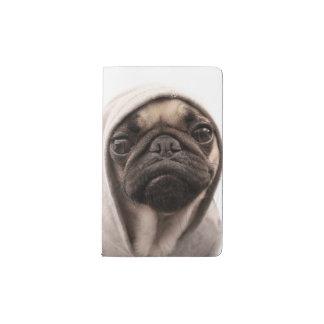Close up of pug wearing hoodie. pocket moleskine notebook