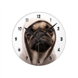 Close up of pug wearing hoodie. wall clocks